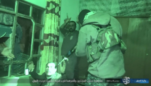 ISIS operative aiming his weapon at the Tribal Mobilization operative.