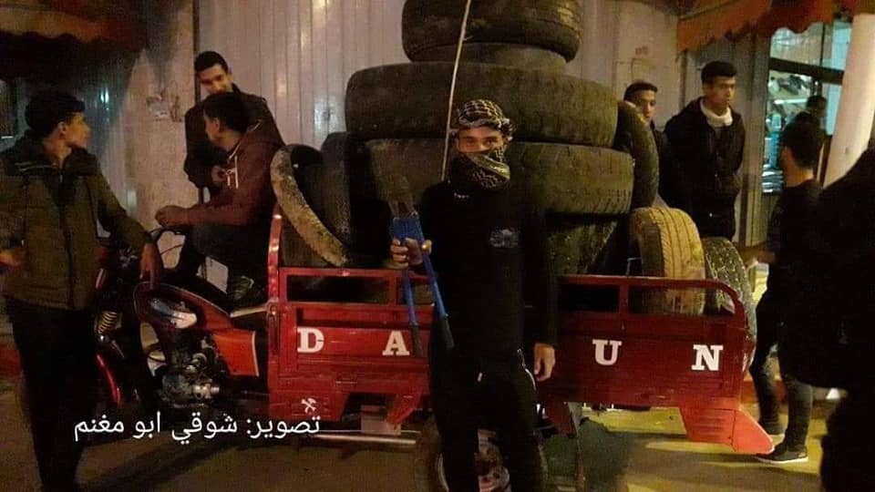 ight harassment unit operatives collect tires for burning (night harassment unit Facebook page, February 13, 2019).