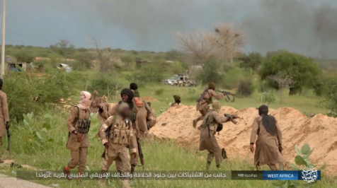 Operatives of ISIS's West Africa Province during an exchange of fire in Nigeria. The logo of the West Africa Province appears on the bottom right (ISIS's West Africa Province, August 12, 2018)