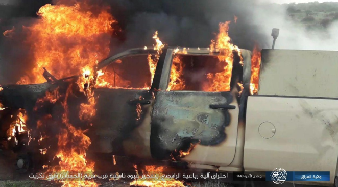 Vehicle of the Iraqi security forces on fire after an IED was detonated against it (Shabakat Shumukh, February 14, 2019)