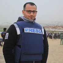 Musa Alian's Facebook profile picture shows him wearing a Press vest.