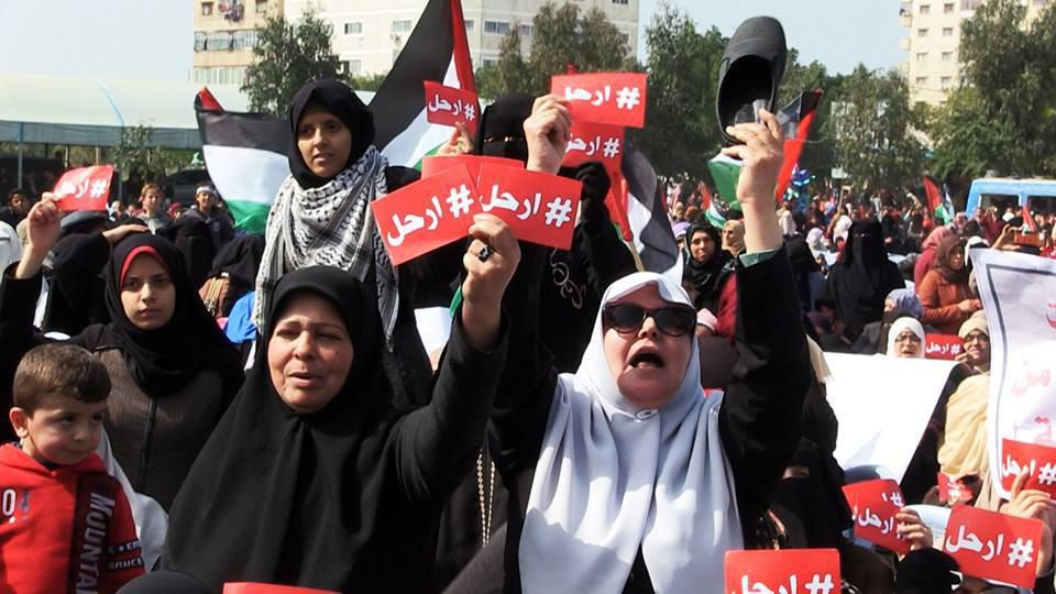 Protesters in Gaza wave signs calling for the resignation of Mahmoud Abbas.