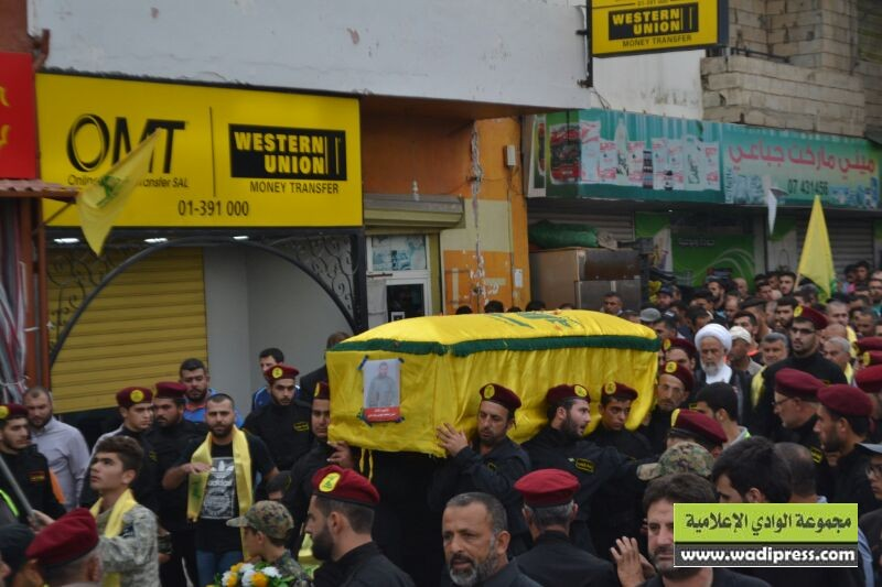 The funeral procession of Hezbollah operative Hassan Abd Ali passes by the OMT branch office in the Shi'ite village of Aitit in south Lebanon (wadipress.com, September 10, 2016). The office also serves Western Union, which shares a telephone number with OMT (the customer service number of its main branch in Beirut).