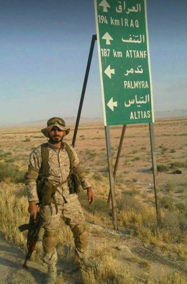 Fatality Hussein Hassan Madi (Baharan) near a road sign in the deserts of eastern Syria (from the Facebook page in his memory)