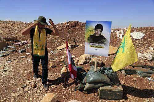 Relative of the fatality Hussein Zuheir Assaf (Nour) visiting the monument in his memory, which was set up at the site of his death in the Al-Qalamoun Mountains (Facebook)