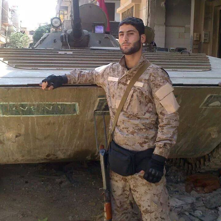 Fatality Musa Ahmed Saqr. Wearing a Hezbollah military uniform next to a Syrian APC.