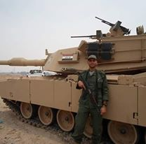 Fatality Hussein Hassib Jaffal, a Hezbollah operative killed in Syria, shown in an Iraqi helicopter (left) and next to an Iraqi army tank (right) from the period when he trained Iranian-affiliated Shiite militias in Iraq.