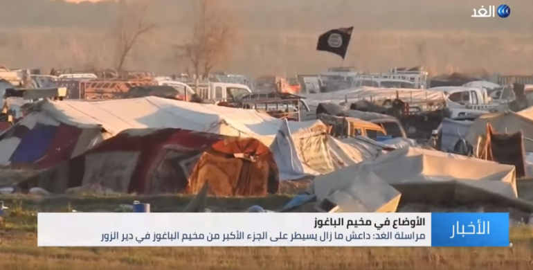 "ISIS flag waved in the ""pocket"" in Al-Baghouz Fawqani (Al-Ghad Channel, March 10, 2019)"