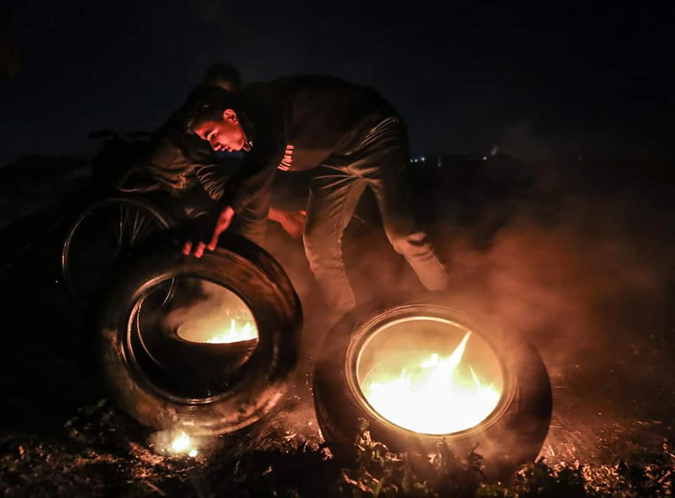 The night harassment unit burns tires in eastern Gaza City.
