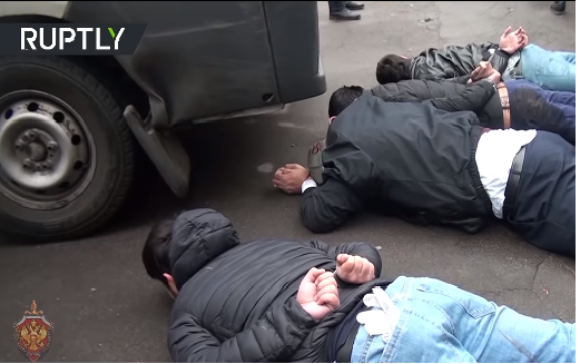 Picture from the video, showing operatives of the squad immediately after their detention (Russia Today YouTube page, October 26, 2018)