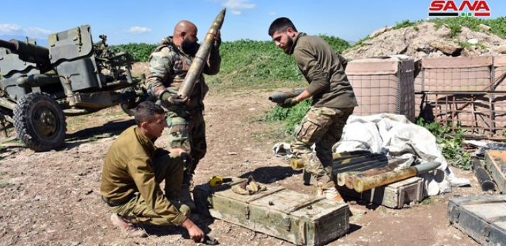 Syrian army soldiers preparing to fire artillery at the rural area south of Idlib (SANA, March 20, 2019).