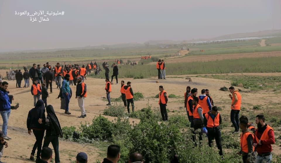 Operatives of Hamas' security forces, wearing orange vests, deploy in the northern Gaza Strip (Palinfo Twitter account, March 31, 2019).