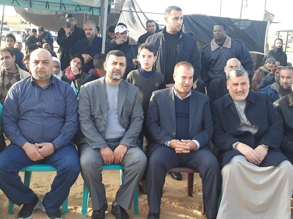 "Ahmed al-Mudallal from the PIJ (right) sitting next to Fathi Hamad at the return camp in eastern Rafah (Facebook page of the ""Support of the intifada in the Rafah district,"" April 5, 2019)."