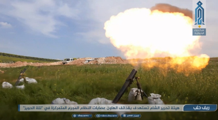 Firing a mortar shell by the Headquarters for the Liberation of Al-Sham at forces of the Syrian army and militias supporting it south of Aleppo (Ibaa, April 7, 2019).