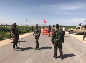 Popular Mobilization fighters manning a mobile checkpoint at one of the entrances to the city of Sinjar, west of Mosul (al-hashed.net, April 15, 2019)