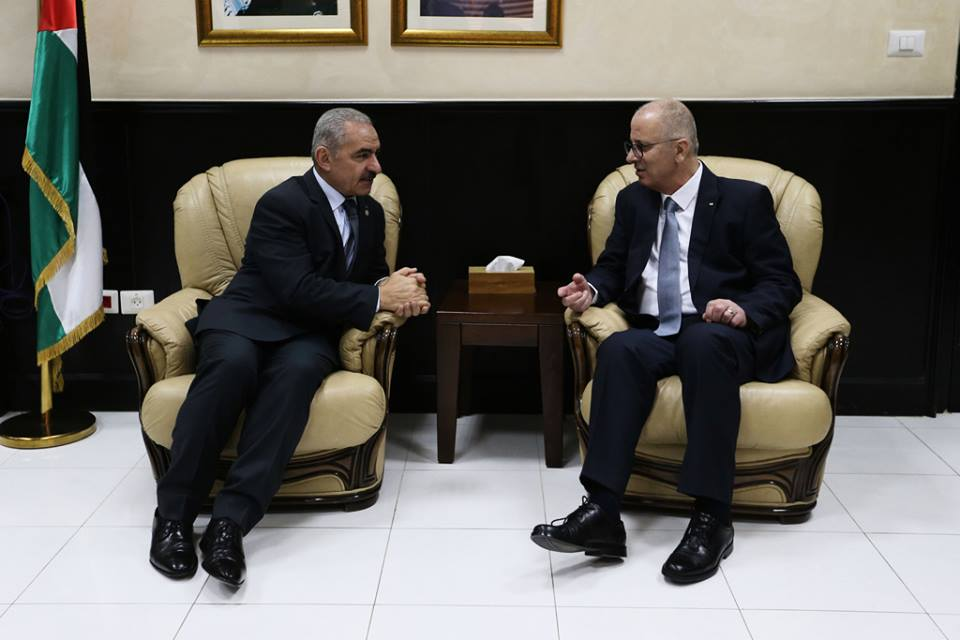 Incoming Palestinian Prime Minister Muhammad Shtayyeh (left) and outgoing Prime Minister Rami Hamdallah (Shehab Facebook page, April 14, 2019).