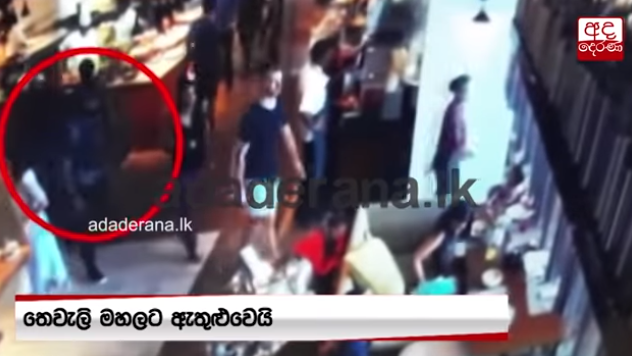 One of the suicide bombers walks towards the hotel restaurant (YouTube channel of ADA derana, the leading news portal in Sri Lanka, April 25, 2019).