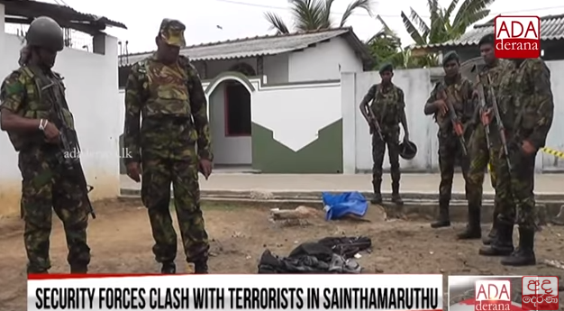 Sri Lankan soldiers standing near the explosive materials found in one of the houses (YouTube channel of ADA derana, April 27, 2019).