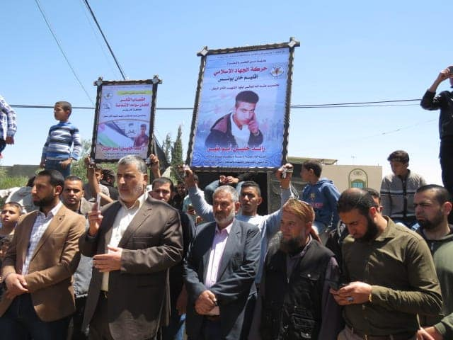"Senior PIJ figure Ahmed al-Mudallal at the funeral of a PIJ terrorist operative, standing in front of a mourning sign of the PIJ's ""intifada wings"" committees (Facebook page of the PIJ's department of women's activities, May 4, 2019)."