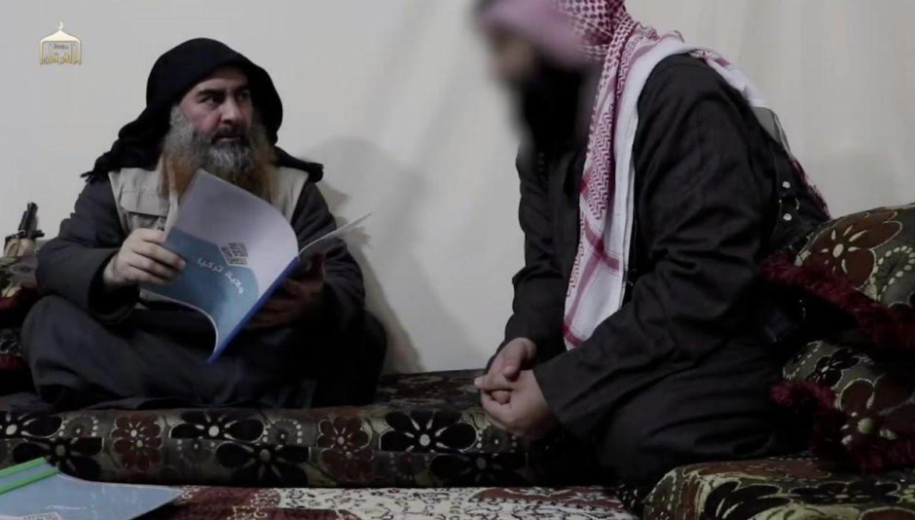"Al-Baghdadi holding a booklet whose cover bears the title ""Turkey Province"" (Akhbar al-Muslimeen, April 29, 2019)"