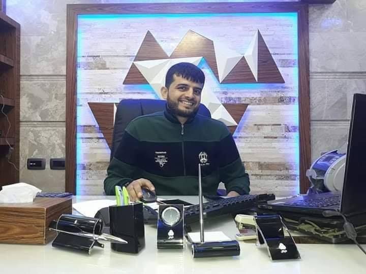 Hamed al-Khoudary in his office in Gaza City (Facebook page of the al-Tufah neighborhood in Gaza City, May 6, 2019).