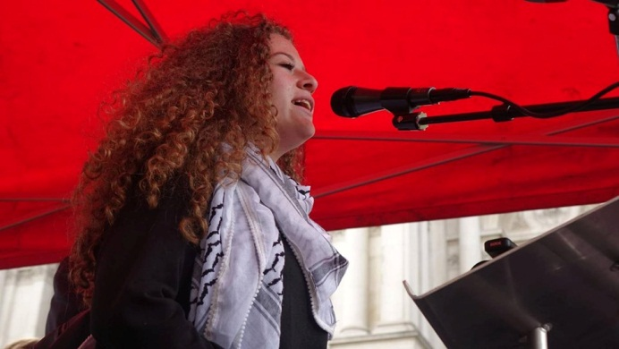 Ahed Tamimi gives a speech at the rally.