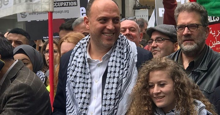 Ahed Tamimi walks next to Husam Zomlot, PA representative in Britain, at the anti-Israeli rally in central London (Husam Zomlot's Facebook page, May 12, 2019).