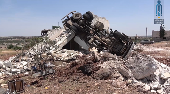 A truck and a building which were hit in the Russian airstrike (Ibaa, May 20, 2019)