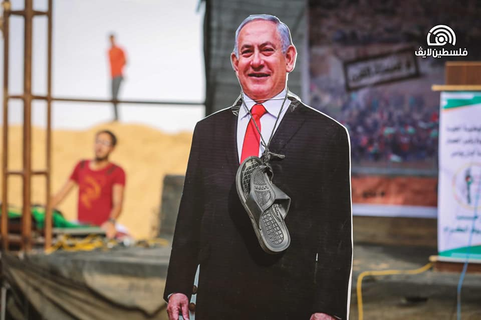 """Effigies of Trump and Netanyahu with sandals attached to humiliate them, and a """"coffin"""" with a picture of Netanyahu and an inscription reading """"the deal of the century,"""" in the return camp in eastern Khan Yunis (Palestine Live Facebook page; bottom left picture from"""
