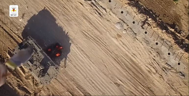 Aerial photograph of two armored vehicles taken by a drone camera.