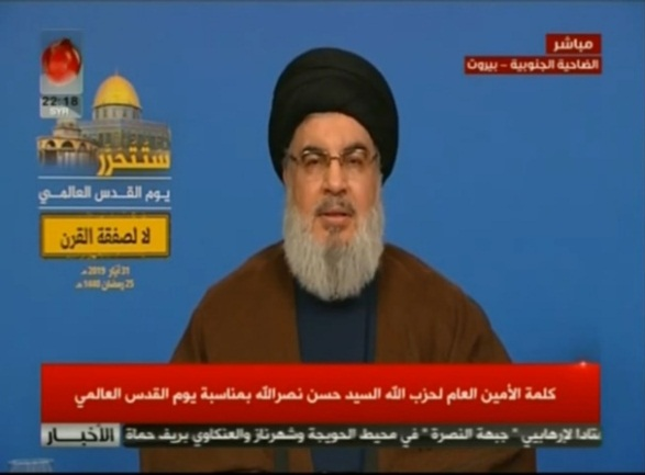 "Hezbollah leader Hassan Nasrallah gives a speech at the main event. In the upper left-hand corner is a picture of the Dome of the Rock, with the inscription ""[Jerusalem] will be liberated, Jerusalem Day, No to the ""deal of the century"" (YouTube)."