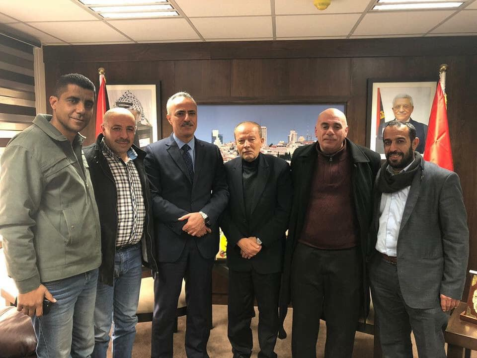 Zakaria Zubeidi (left) with Ali Abu Diyak at the time the Palestinian minister of justice (third from left),; and Qadri Abu Bakr, Commission chairman (fourth from left) (Zakaria Zubeidi's Facebook page, January 13, 2019).