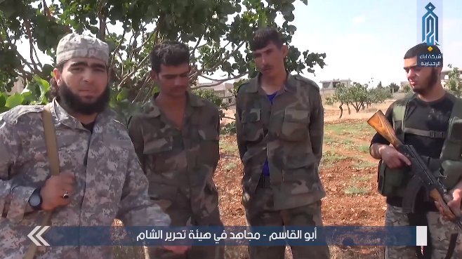 Two Syrian army soldiers taken prisoner by the Headquarters for the Liberation of Al-Sham in the village of Jubain, near Tal al-Malah (Ibaa, June 15, 2019)