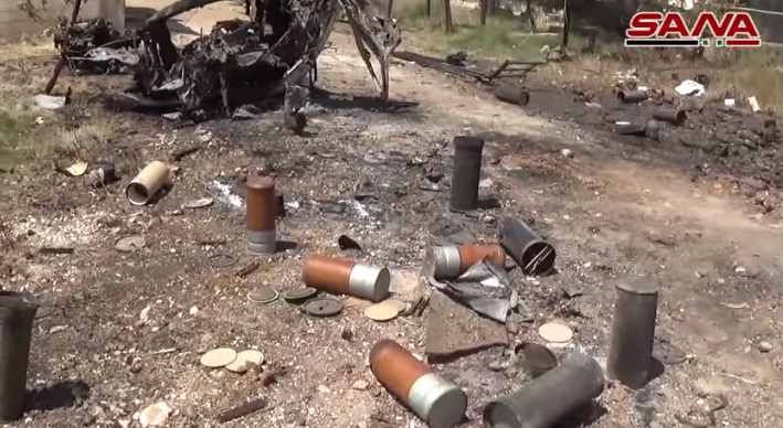 Rebel vehicle destroyed by the Syrian army on the road between Al-Hamamiyat and Al-Jubain (SANA, June 13, 2019).