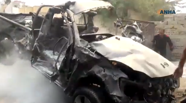 One of the vehicles which were destroyed in the explosion of the car bomb near the Kurdish internal security headquarters.