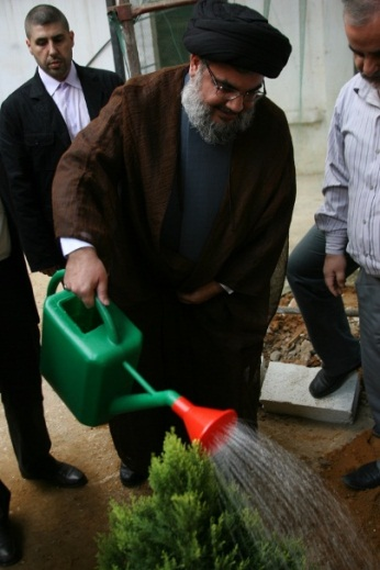 Hezbollah Secretary General Sayyid Hassan Nasrallah planting the one millionth tree in 2010 (Jihad al-Bina website).