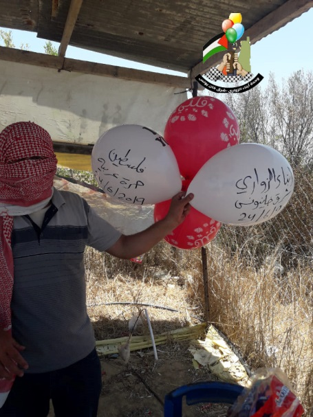 The Sons of al-Zawari, eastern Khan Yunis unit, launch incendiary balloons into Israel on June 24, 2019 (Sons of al-Zawari, eastern Khan Yunis' Facebook page, June 24, 2019).