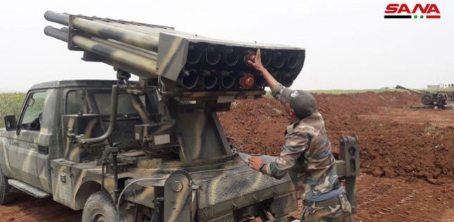 Operatives of the National Front for Liberation firing a Grad rocket at Syrian army forces near Tal al-Malah and Jubain (YouTube channel of the National Front for Liberation, June 20, 2019). Left: Syrian army soldiers prepares rockets for launch at the area controlled by the rebel organizations in the rural area northwest of Hama (SANA, June 20, 2019)