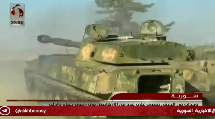 Syrian army self-propelled gun fires at forces of the Headquarters for the Liberation