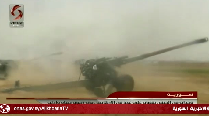 Syrian army artillery fire at operatives of the Headquarters for the Liberation of Al-Sham and the Battalions of Glory on the road between Tal Malah and Wadi Othman (Al-Ikhbariya Channel, Syria, June 29, 2019)