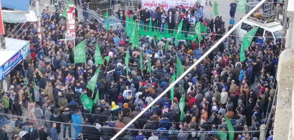 Hamas march in Gaza City to celebrate the killing of two Israelis.