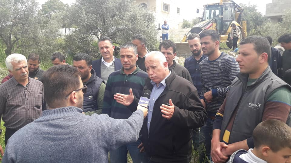 The secretary of the Fatah branch in Salfit announces the construction of a new house for the terrorist's family.