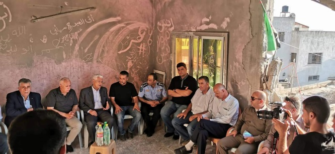 Abbas Zaki visits the demolished house of Omar Abu Layla's family in the village of al-Zawiya (Facebook page of the Fatah branch in Salfit, June 22, 2019).
