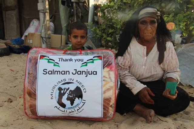The logo of Muslims In Need on packages containing winter blankets, distributed by the Generosity Association to needy families in the Rafah district (Generosity Association website, October 30, 2016).