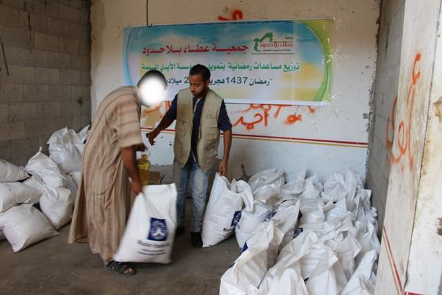Sign thanking the Generosity Association and Muslim Hands for aid distributed during Ramadan (Generosity Association Facebook page, June 22, 2016), along with sacks of food bearing the organization's name (Generosity Association Facebook page, June 19, 2016).