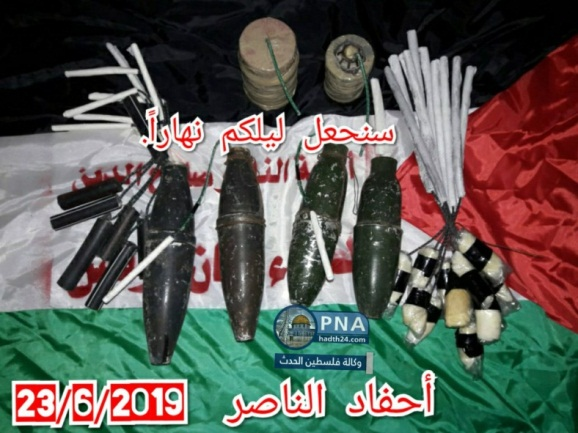 "The Units of the Descendants of al-Nasser send a threat to Israel: ""We will turn your nights into day."" The picture shows IEDs and Molotov cocktails with fuses in preparation for being attached to balloons and launched into Israel (PAL Hadath Twitter account, June 23, 2019)."