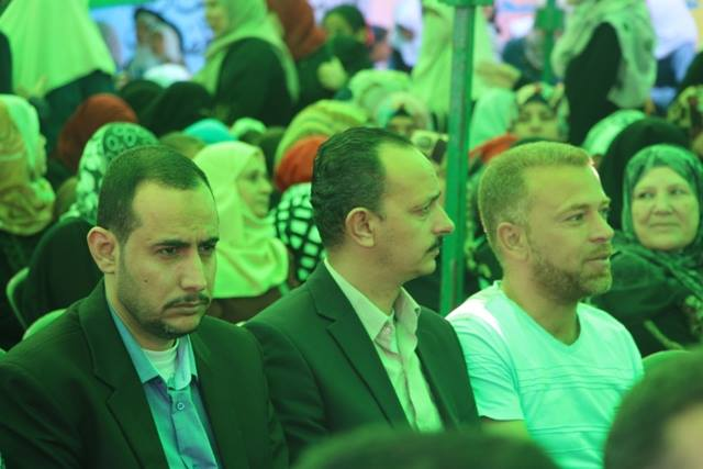 Abdallah al-Hamayda (right) sits next to Rami al-Nairab and Jibril al-Soufi, two senior figures in the Generosity Association at a ceremony organized by the ministry of education in Rafah (Watan Charitable Association Facebook page, April 21, 2016).