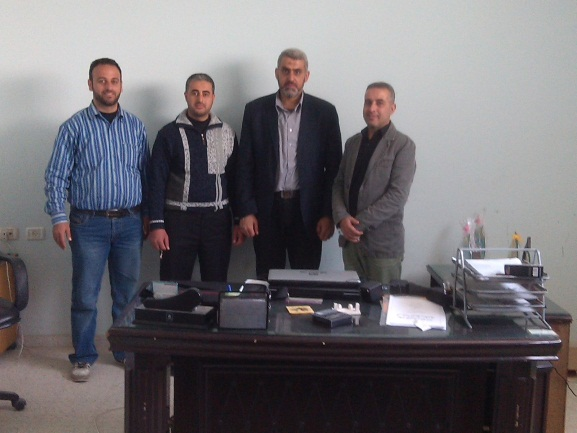 Ali al-Sheshniyah (second from right) in the office of the al-Bureij Association for the Rehabilitation of the Disabled (Abu Ziyad Mansour's Facebook page, April 7, 2016).