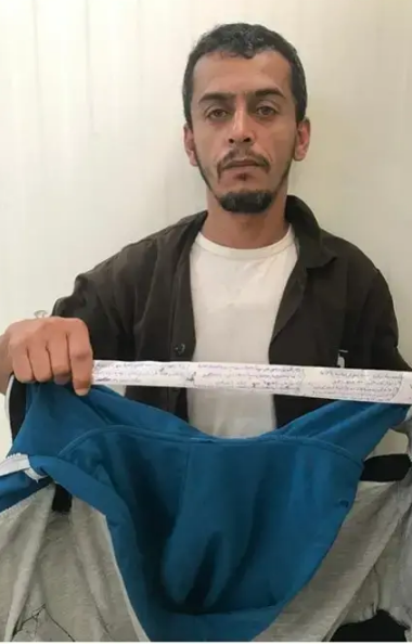 Fadi Abu al-Subah, who was recruited to Hamas' military wing and entered Israel by exploiting a permit to receive medical treatment. He is holding a strip of material with code words, which was hidden inside his jacket (Israel Security Agency, July 3, 2019).