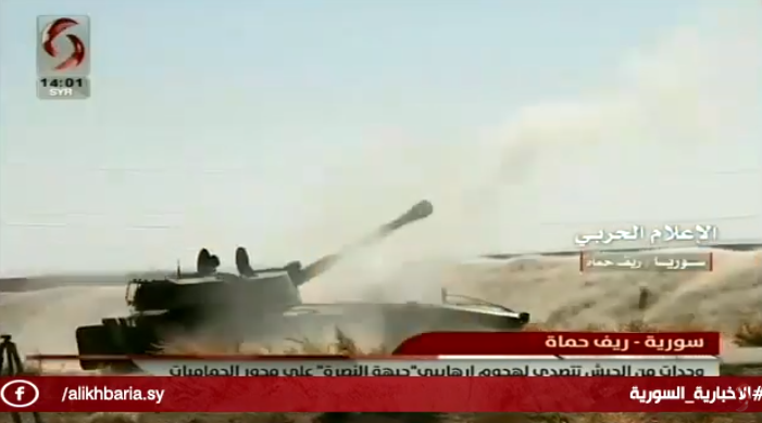 Syrian army tanks and artillery fire at operatives of the Headquarters for the Liberation of Al-Sham who advanced on the route leading to Hamamiyat (Al-Ikhbariya Channel, July 6, 2019)